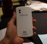 White Nexus 4 photos surface next to a nice cake