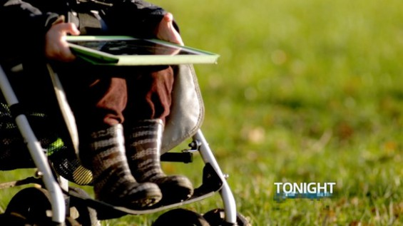 A young tablet user on the move Photo: ITV / Tonight