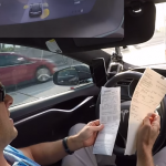 Inside a self-driving car at 75mph whilst the driver is browsing the web and doing paperwork