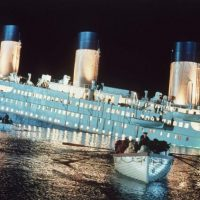 As the ship sinks, lifeboats are rowed away in this scene from the epic film 'Titanic.'  At $200 million, it is the costliest movie ever made and most anticipated of the holiday season. It is scheduled for release Dec. 19, 1997. (AP Photo/HO-Merie W. Wallace)