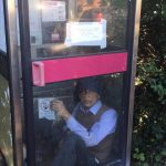 LIVE – Man refuses to leave phone box as BT try to remove it