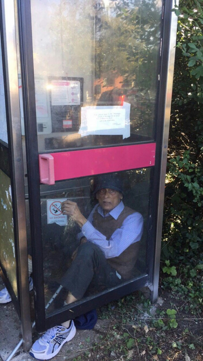 LIVE   Man refuses to leave phone box as BT try to remove it