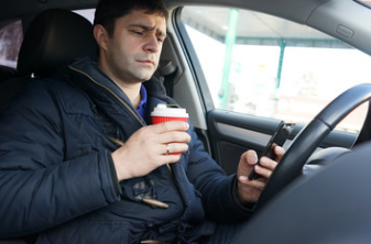 Driving and using the phone? Fines and points to double