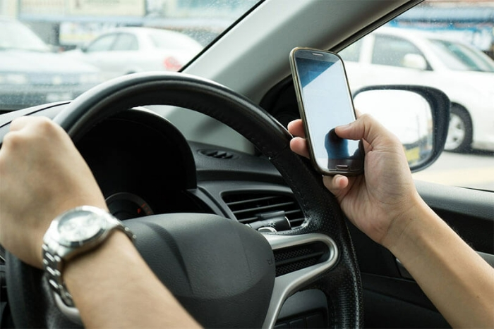 New tougher mobile laws live today for drivers