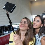 Selfie stick? Phone cover? Combined? Boom!
