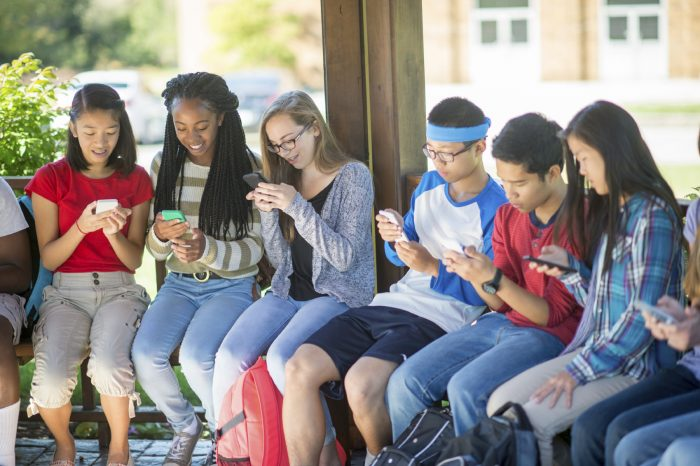 Students Texting on Their Cell Phones