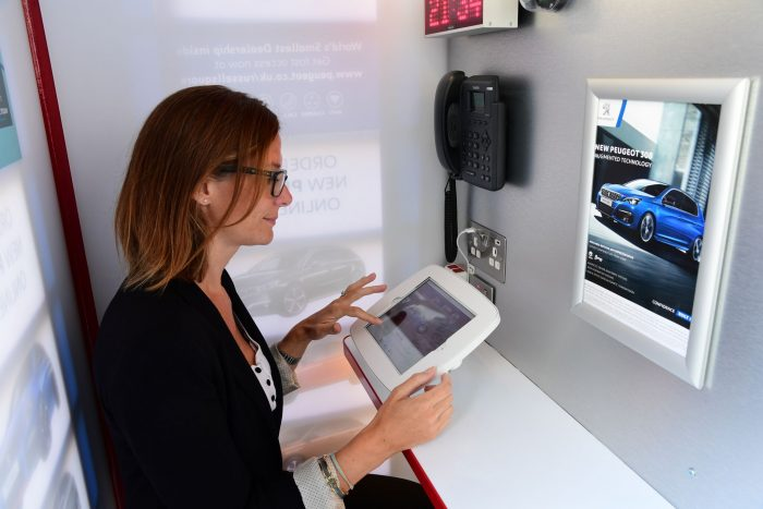 Peugeot announce new car dealership... in a phone box