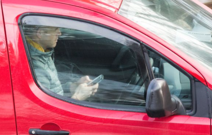 People are still using their phones at the wheel